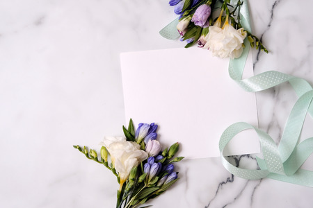 Mockup card with plants. Invitation card with environment and details. Postcard and flowers. Minimalistic card mockup. Flat lay, top view. mothers day mockup. womans day mockup.