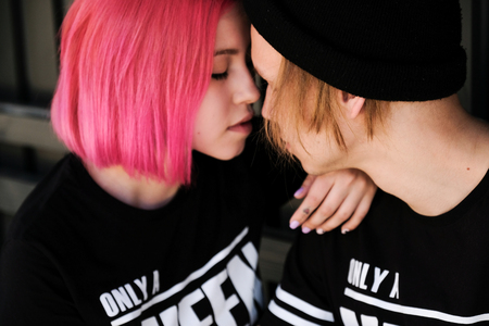 Couple in love. Close up portrait of redhead girl and hipster young boy. Stock Photo