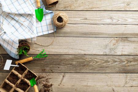 Gardening equipment on wooden background. Spring garden works concept. Top view, flat lay
