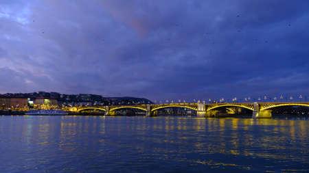 Panoramic view of illuminated Margaret (Margit) bridge at night in Budapest, Hungary