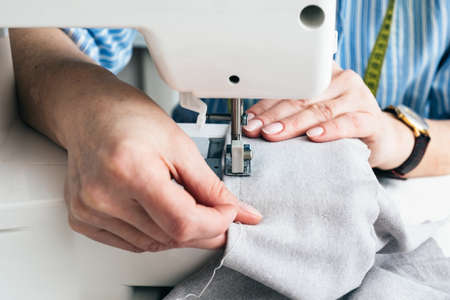 Tailor tears off the label at workshop