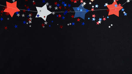 Happy Independence Day banner template, 4th of July celebration concept. Blue red white confetti and stars in USA national colors on black background.