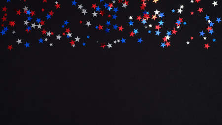 Blue red white confetti stars in USA national colors on dark background. Happy Independence Day banner template, 4th of July celebration concept.