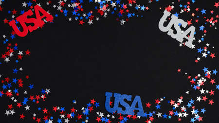 Red white blue confetti and USA signs on dark background. 4th of July patriotic banner mockup, Happy Independence day concept. US national holidays celebration.