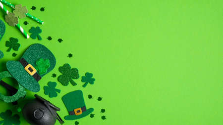St Patricks Day banner design with Irish elf hats, pot of gold, shamrock and four-leaf clovers on green background. Happy St. Patrick's Day concept. Greeting card template, poster, flyer mockup