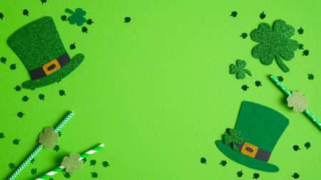 St Patricks Day banner design. Frame of shamrock and four-leaf clover, Irish elf hats, party drinking straws. Happy St. Patrick's Day concept. Greeting card template, poster, flyer mockup