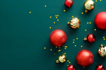 Vintage Christmas composition with red and golden balls on green background. Flat lay, top view, overhead. Merry Christmas banner design, Happy New year greeting card mockup