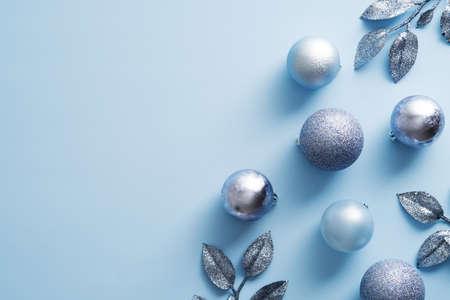 Elegant Christmas decorations on blue background. New Year banner design, Christmas flyer mockup.