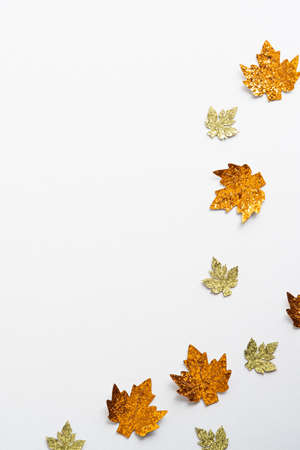 Autumn composition. Frame made of golden maple leaves decorations on white background. Flat lay, top view. Minimal style. Standard-Bild
