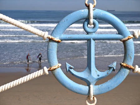 water anchor: Blue anchor sign on the beach parapet Stock Photo