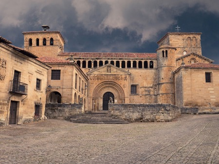 juliana: Colegiata y Claustro de Santa Juliana church in Santillana del Mar, Cantabria, Spain on the stormy sky background Stock Photo