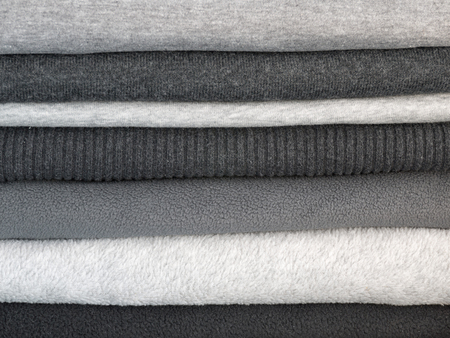 sweats: Stack of warm clothes in different shades of gray