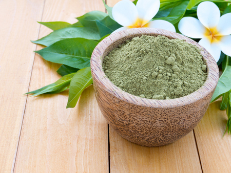 colorant: Henna mhendi colorant powder in the coconut bowl and tiare flowers