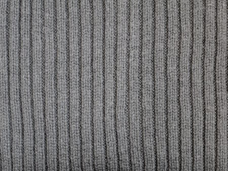 ribbed: Gray ribbed knitted wool fabric cold weather background