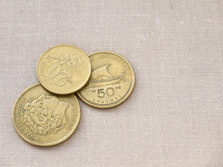 greek currency: Greek drachma coins on the canvas background