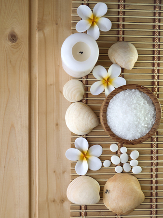 Shells,stones and tiare flowers on the wooden background