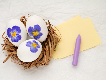 violas: Three Easter eggs with violas Stock Photo