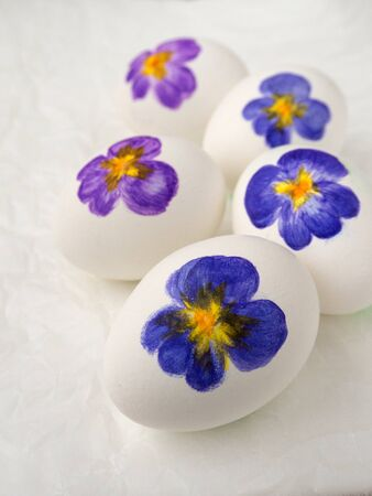 colored dye: Five Easter eggs with viola painting Stock Photo