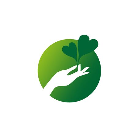 agronomics: Two hearts shaped green leaves in the hand garden care concept