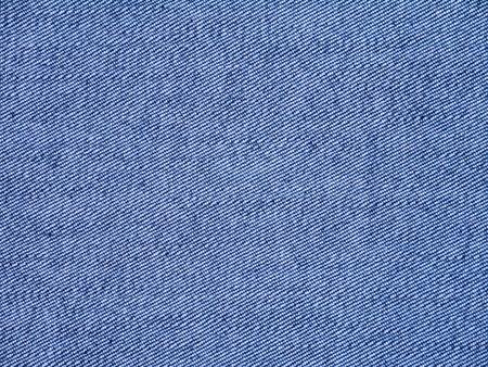 washed: Blue washed denim fabric inside out background