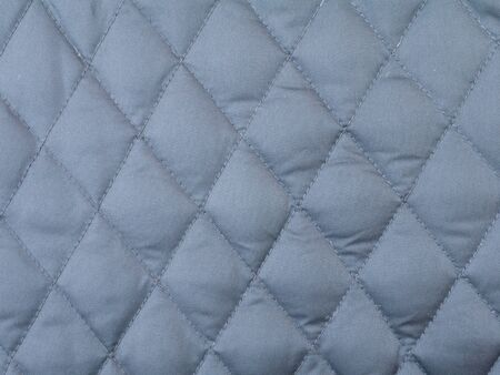 quilted: Dark grey rhombus quilted winter cloth background
