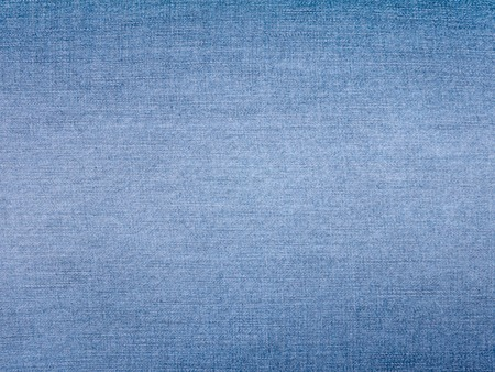 Faded light blue jeans denim fabric background