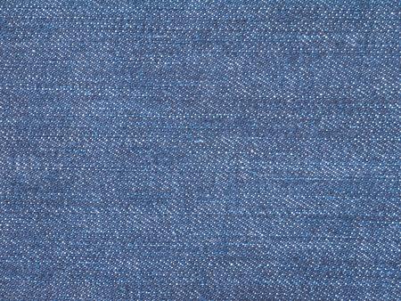 denim fabric: Dark indigo jeans denim fabric closeup background