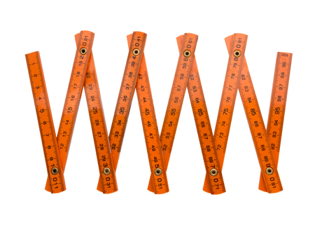 depth measurement: Orange folding plastic centimeter isolated on white Stock Photo