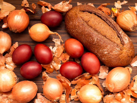 onion peel: Red colored Easter eggs, onions, onion peel and homemade rye bread
