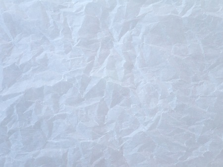 paper sheets: Off white crumpled wax paper sheet background Stock Photo