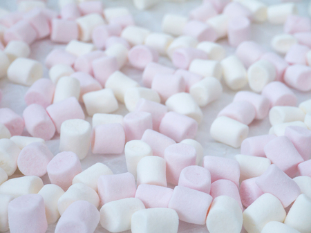 shallow: White and pink marshmallow shallow focus background