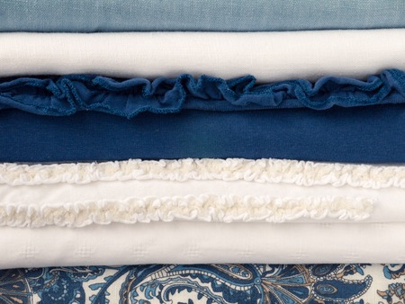breezy: Breezy summer white and blue seaside clothes with different textures Stock Photo
