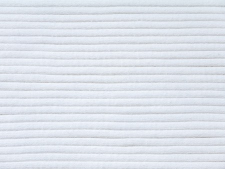 ribbed: Off-white ribbed knitted cotton fabric cool weather background Stock Photo