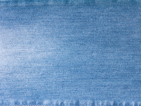 Light blue washed faded denim fabric background 写真素材