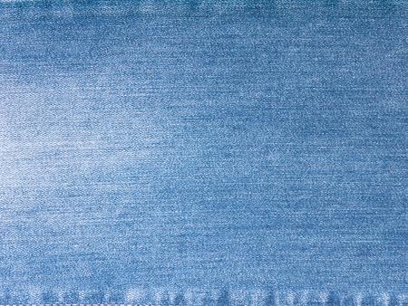 washed: Light blue washed faded denim fabric background Stock Photo