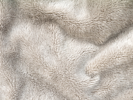 fleece: Beige folded fluffy polyester cozy fleece fabric background