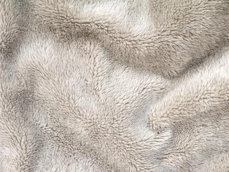 fleece fabric: Beige folded fluffy polyester cozy fleece fabric background