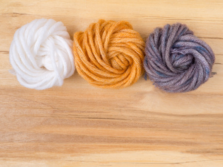 Wool bun swatches colored by henna and indigo and control white sample Stock Photo