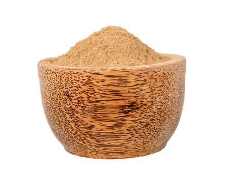 Amalaki emblica officinalis superfood powder in the wooden bowl isolated on white