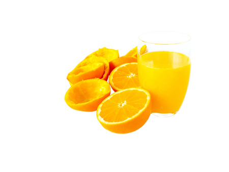 Fresh orange juice in the glass and orange fruits halves and peel isolated on white Stock Photo