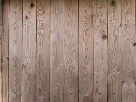 rivets: Wooden brown planks with metallic rivets background