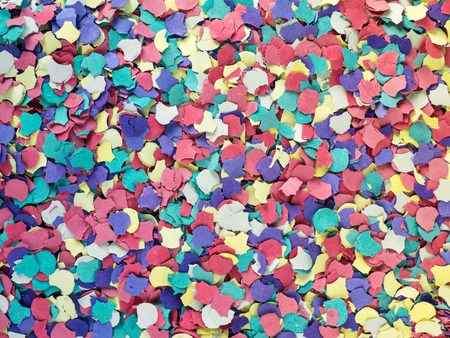 Colorful confetti background. Carnival and holidays attribute. Recycling cardboard confetti heap.