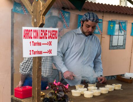 OVIEDO, SPAIN - May 12, 2018: Rice with milk asturian traditional dessert making master class on the Ascension Fair, Oviedo, Spain.