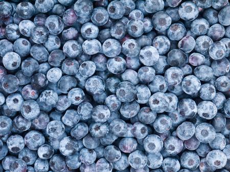 Ripe dark purple blueberry berries background