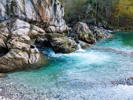 Crystal clear aquamarine waters of the Dobra mountain river in the Asturias in the North Spain