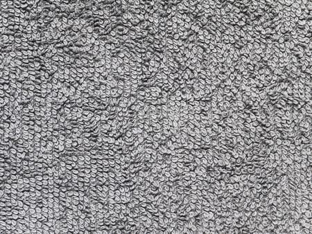 Bath towel gray cotton terry fabric texture. Terrycloth texture swatch. Reklamní fotografie