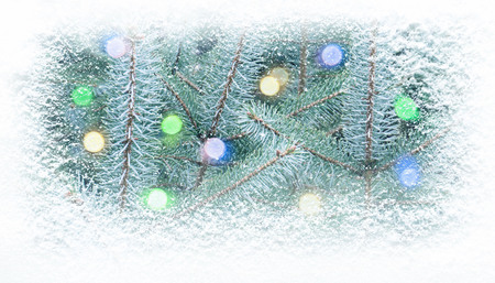 Christamas and new year fir tree decorated with multicolor lights covered with snowfall horizontal banner background. Reklamní fotografie - 117093481