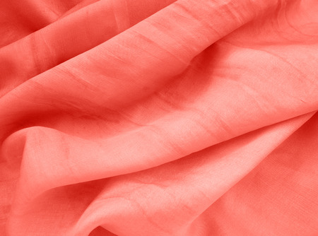 Coral natural silk background. Top color trend of the year 2019. Stock fotó