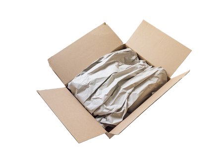 Opened postal package box full of goods covered by brown recycled wrapping paper isolated on white. Surprise gift delivery. Reklamní fotografie - 117093626