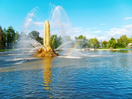 MOSCOW, RUSSIA - July 22, 2019: Golden Spike fountain at the Kamensky Pond on the Exhibition of Economic Achievements (VDNKh) in Moscow, Russia.